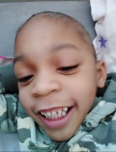 Terrence smiles at the camera in a selfie he took by himself. You can see every tooth in his smile.